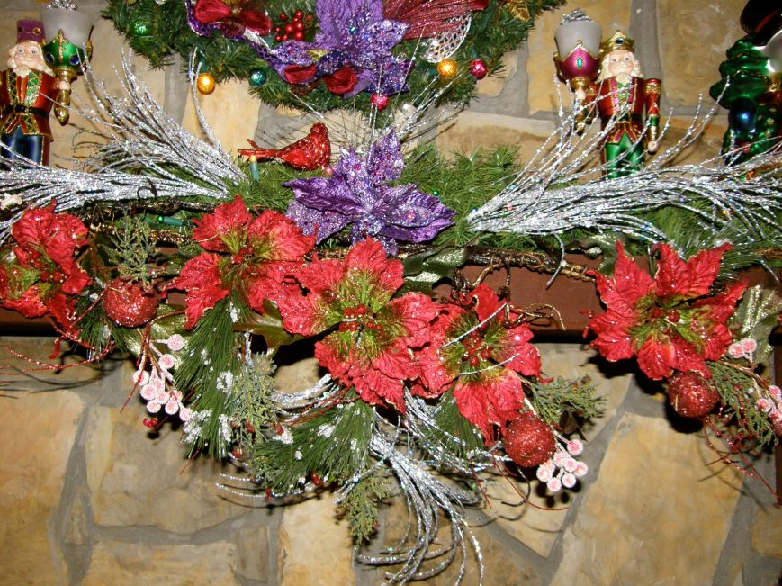 Each year I start with plain garland for my mantles, I add lights, and then I decorate it with a mixture of flowers, things I find in the floral sections and picks I find in the Christmas decoration section.