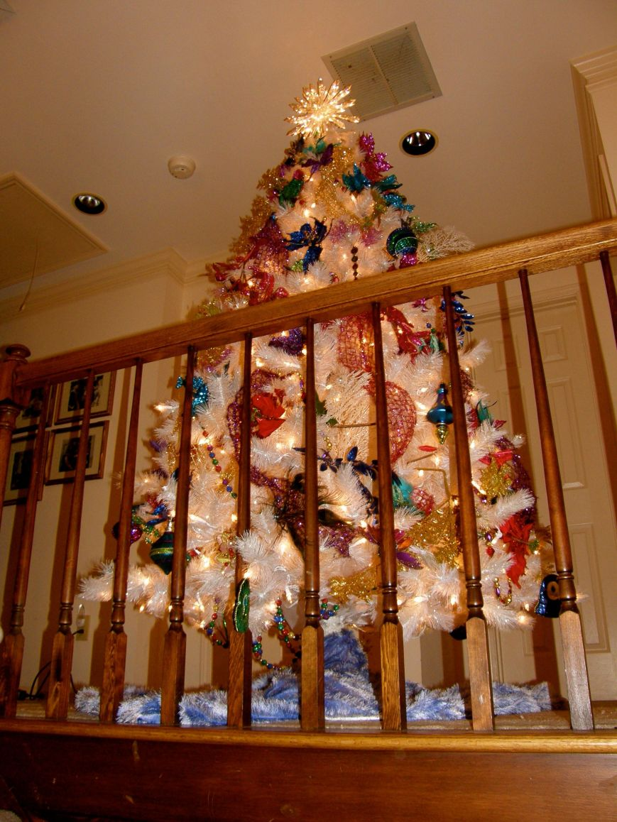 The white tree sits upstairs on a landing that you see from the foyer and from a big Palladian window when you are driving down the driveway.