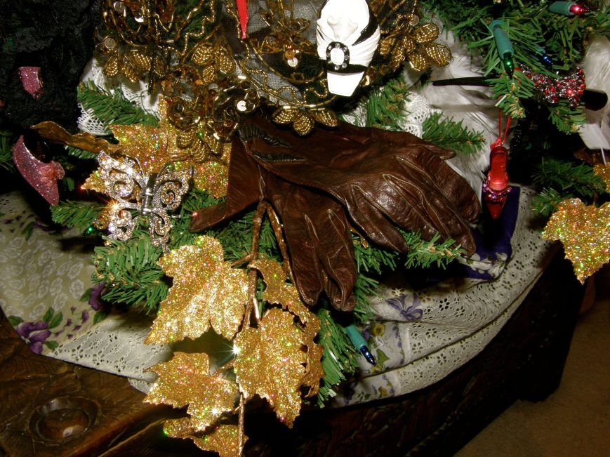 I use hair clips and costume jewelry as ornaments to create sparkle and keeping with the fashion part of the tree theme.