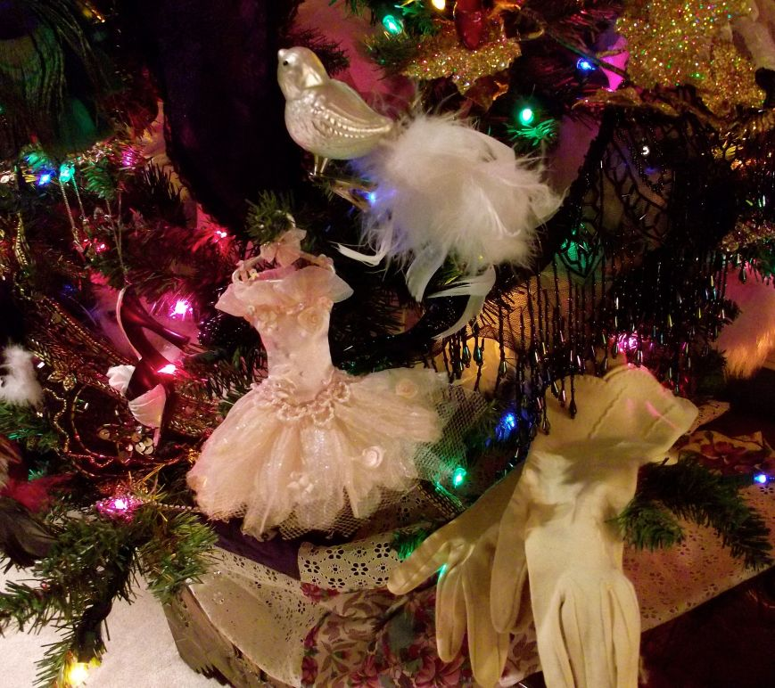 This tree is all about sparkle, fashion and seduction.  I have several pairs of gloves on the tree that were from grandmothers on my side of the family and on my husband's side.