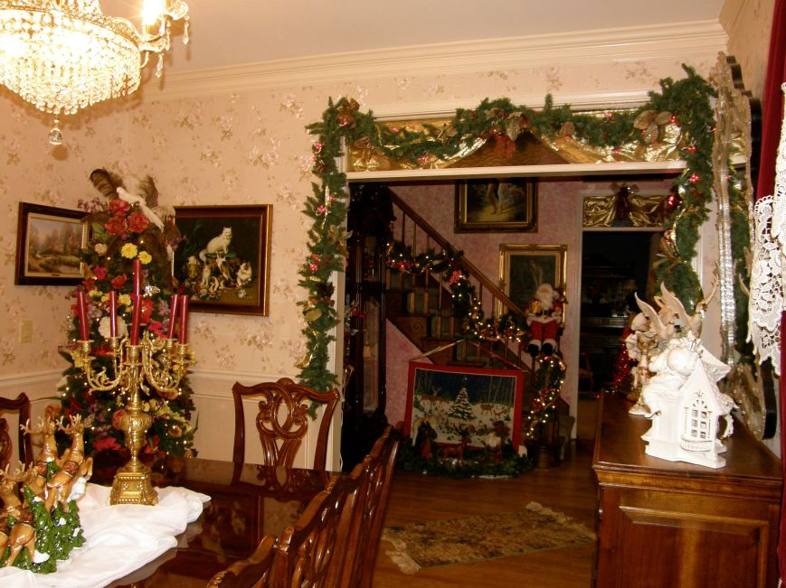 Here is a partial view of the dining room and foyer.  I decorate almost the whole house, even the bathrooms.  I know I go a little overboard, but my husband and I love celebrating Christmas.