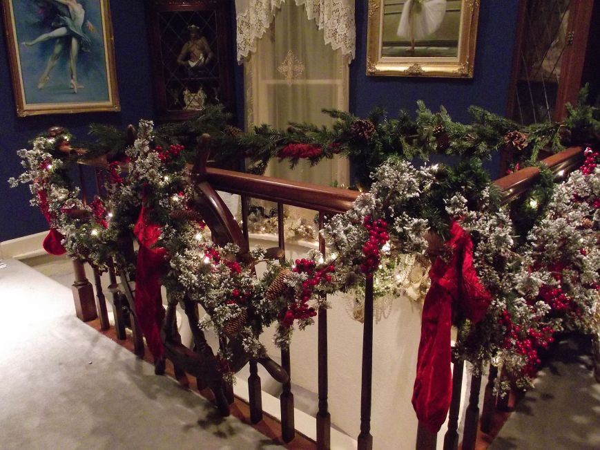 The Parlor Stairway, this garland was bought pre made, I just added it to plain garland to add more fullness which allowed room to put lights on, and then added velvet stockings.