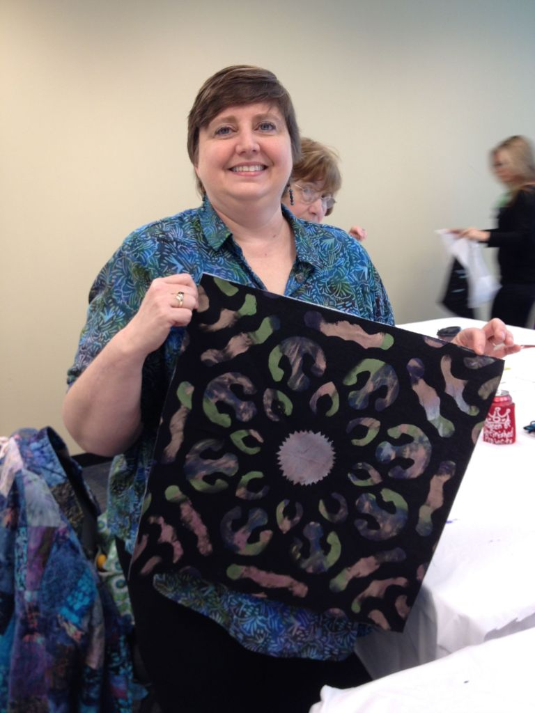 Student Laurie with the fabric that she painted. Yes, she is more talented with painting.