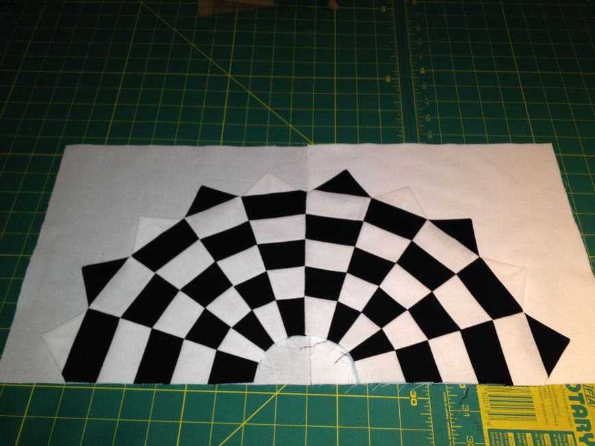 Two individual squares I made in the Vortex Quilt workshop.